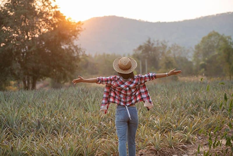 Girl in field arms open